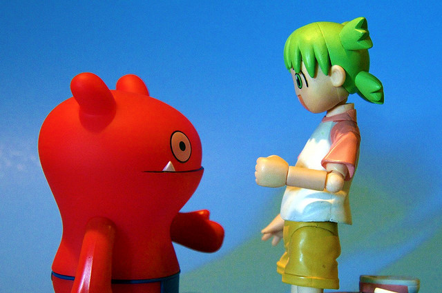 """Two action figures face off in a round of """"rock, paper, scissors."""""""