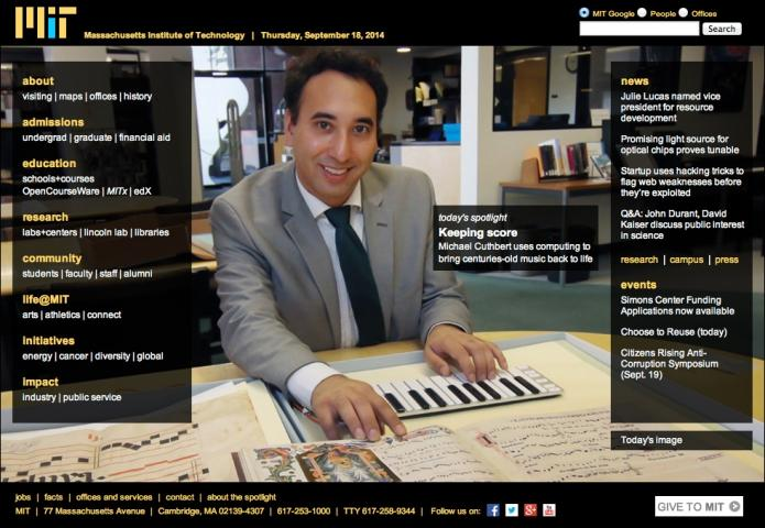 Professor Michael Cuthbert on MIT's homepage, his hands on a piano keyboard and a musical text.