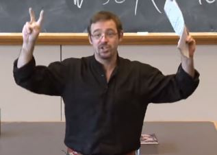 "Prof. Adams gesturing with ""air quotes""."