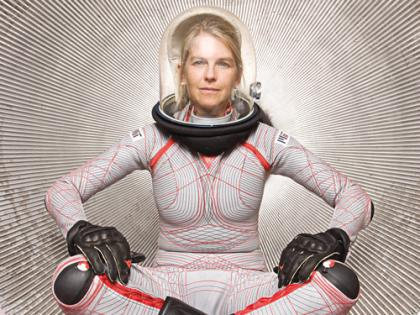 A woman wearing a form-fitting space suit.