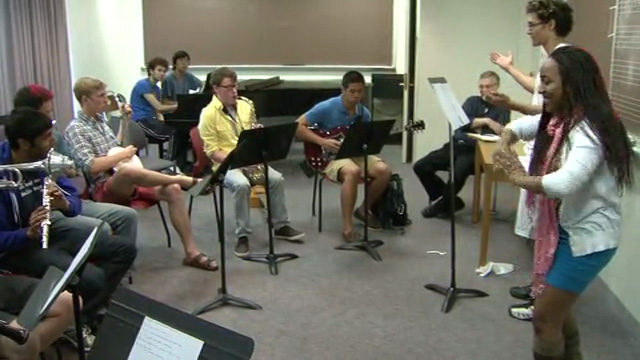 Photo of two students conducting a group of student instrumentalists.