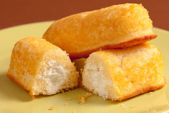 A plate of yellow cream-filled sponge cakes