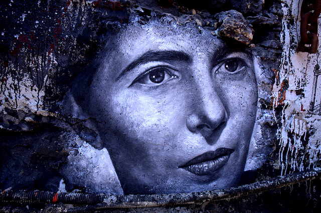 Photo of a mural showing a woman's face in closeup.