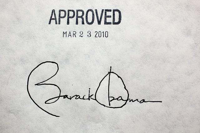 "Image of Barack Obama's signature, stamped ""Approved - Mar 23 2010."""