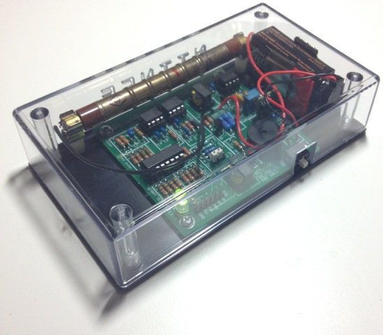 Photo of electronics on a circuit board within a clear plastic box.