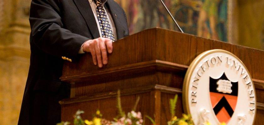 Photo of man standing at a Princeton University lectern, giving a speech.