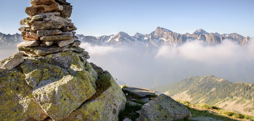 Photo of rock cairn on a mountaintop.