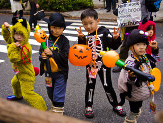 Photo of four young children in Halloween costumes.