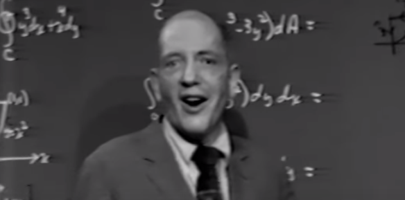 Herb Gross standing in front of a blackboard
